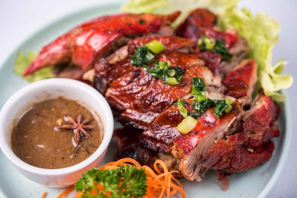 A photo of Roast Duck with 5 Spice Sauce food dish at the Vietnam Restaurant