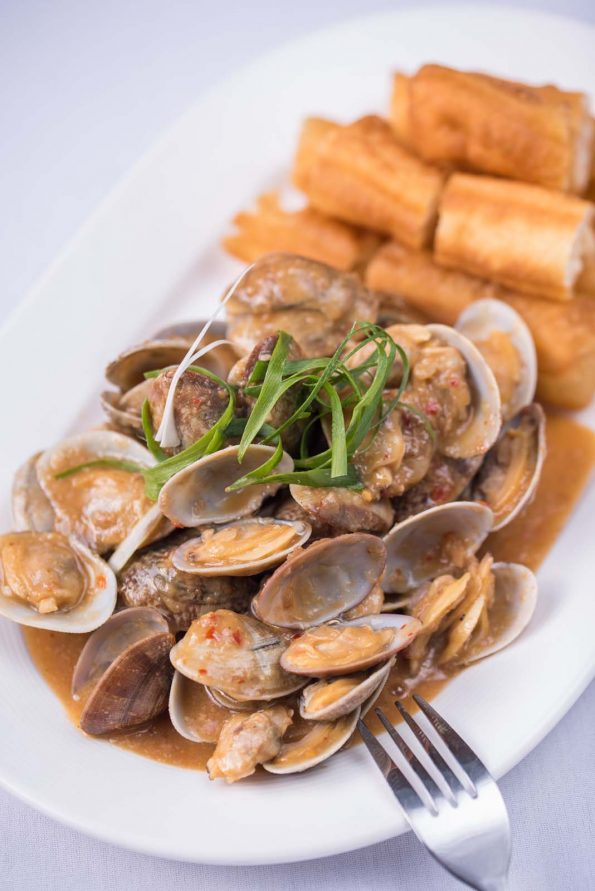 A photo of Clams with VNR Reserved XO Sauce & Chinese donut